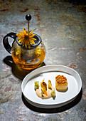 Scallops with Jerusalem artichokes, chestnuts and Jerusalem artichoke flower tea
