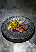 Charcoal-grilled saddle of pork grilled with sweetcorn, chickweed and bacon