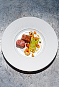 Saddle of venison with pointed cabbage and chorizo oil
