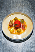 Tuna with variations of tomatoes and faux olives