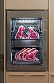 Meat maturing in a dry ageing cabinet