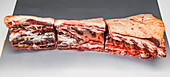 Saddle of beef being halved lengthways