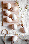 Easter eggs colored with coffee and decorated with cosmetic pencil