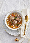 Beef broth with homemade noodles and dumplings