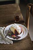 Traditional Neapolitan rum baba with whipped cream