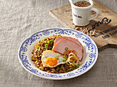 Sour lentils with smoked meat and egg