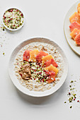 Porridge with colorful oranges, pumpkin seeds and peanut butter