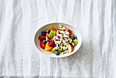 Fruit salad with cocoa granola