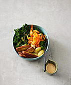 Kale and carrot bowl with a walnut sauce