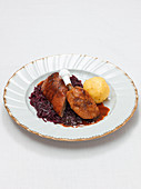 Roasted duck with dumplings and red cabbage