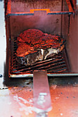Steak being grilled in a Beefer