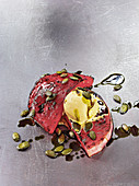 Watermelon made in a Beefer with pumpkin seed oil and vanilla ice cream