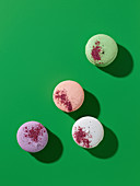 French macaroons decorated with colorful food powders