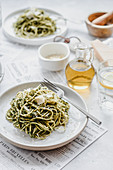 Spaghetti with pesto and parmesan cheese