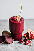 Beetroot smoothie with raspberries pomegranate and currants