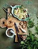Mushrooms and turmeric mayonnaise with fresh herbs, mushrooms and bagels