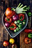Fresh vegetables in an enamel bowl