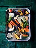 Raw root vegetables on a baking tray