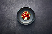 Marinated cherry tomatoes with Castello Blue ice cream and saffron broth