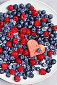 Blueberries, raspberries and a watermelon heart