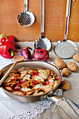 Gratinated chicken with peppers, potatoes and mozzarella