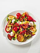 Lukewarm vegetable salad with mozzarella