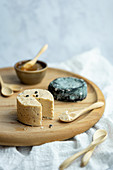 Vegan Fermented Cheese on a Wood Tray