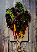 Colorful rainbow swiss chard on a wooden board