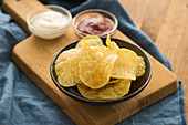 Crispy potato chips with ketchup and sour cream