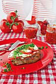 Spicy pork collar steaks gratinated with mozzarella