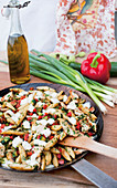 Fried potato orzo pasta and vegetables with chicken and mozzarella