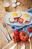 Ham and eggs on toast with mozzarella