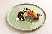 Pigeon-stuffed quail with morel mushroom rilette and Bibbeleskäse (white cheese made from quark with herbs)