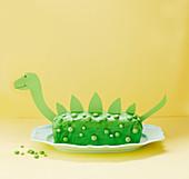 A dinosaur cake (hazelnut cake with green glaze)