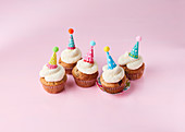 Poppyseed and cherry muffins with party hats