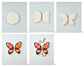 A butterfly cake being put together