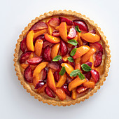 Apricot and plum crostata with ginger cream