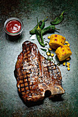Grilled porterhouse steak with corn on the cob