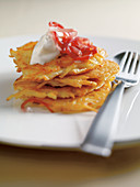 Potato fritters with chopped ham and sour cream