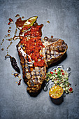 Grilled T-bone steak with Moroccan seasoning marinade and couscous