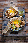 Spaghetti parcels with salmon and oranges