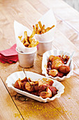 Curried sausage with homemade chips