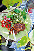 Stuffed mozzarella veal burgers with herb pasta and tomatoes