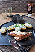 Gratinated mozzarella steaks with sour cream potatoes