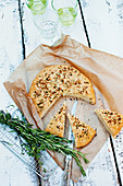 Stuffed focaccia with mozzarella, thyme and rosemary
