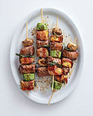 Grilled sausage skewers with mushrooms, provolone and zucchini