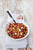 Vegetarian chilli with freekah and mozzarella