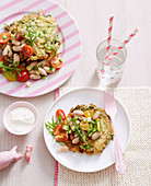 Green vegetable fritters with tomato salad
