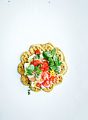 Felafel waffle with labneh, cherry tomato, radish, parsley and mint