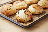 Burger buns on a baking sheet